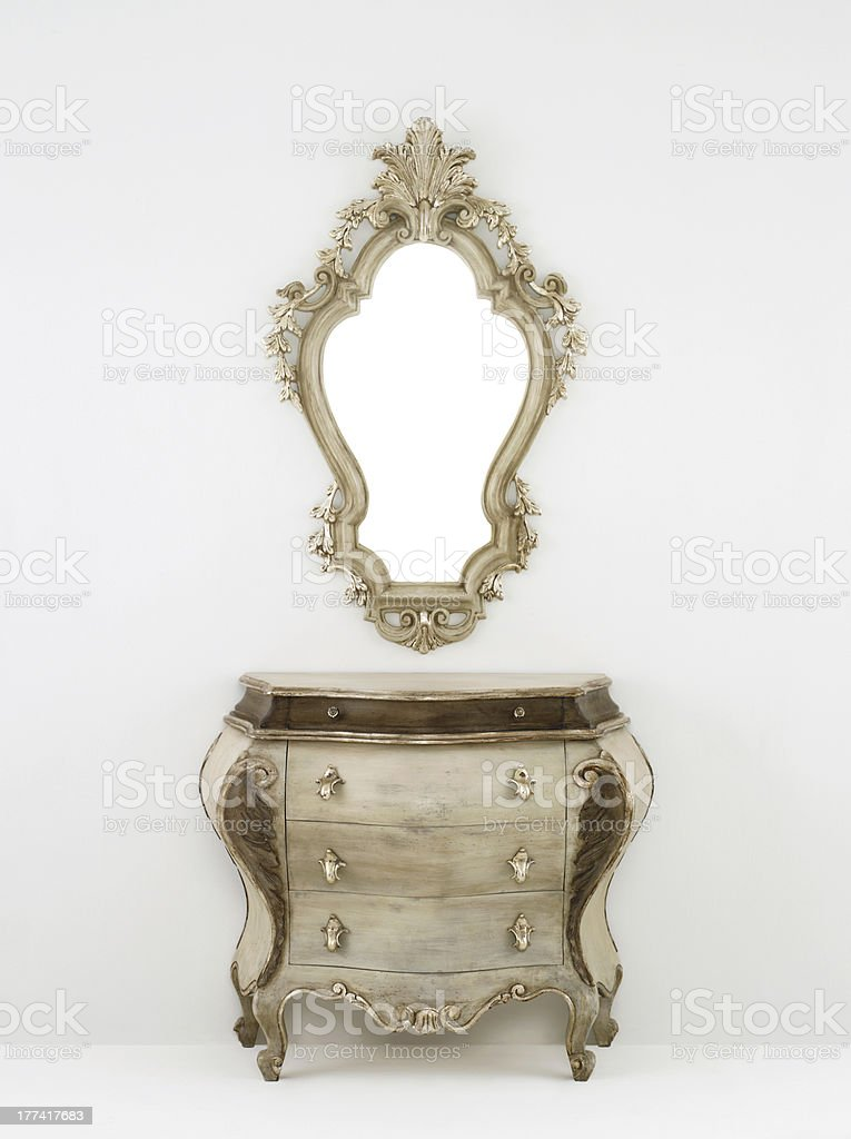 Retro wooden chest of drawers with mirror stock photo