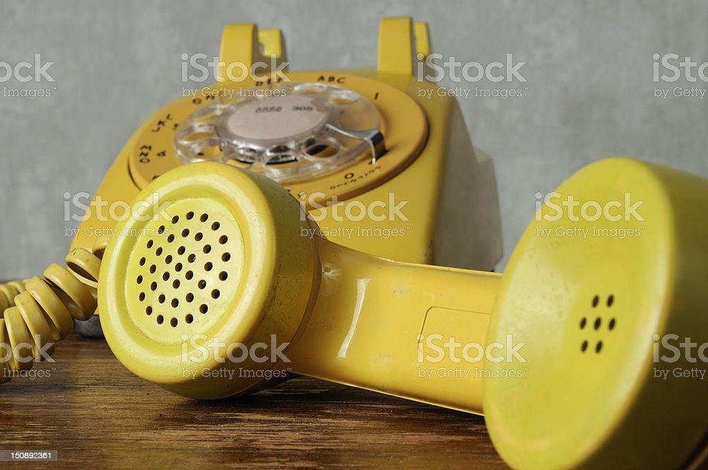 Retro Yellow Rotary Phone stock photo