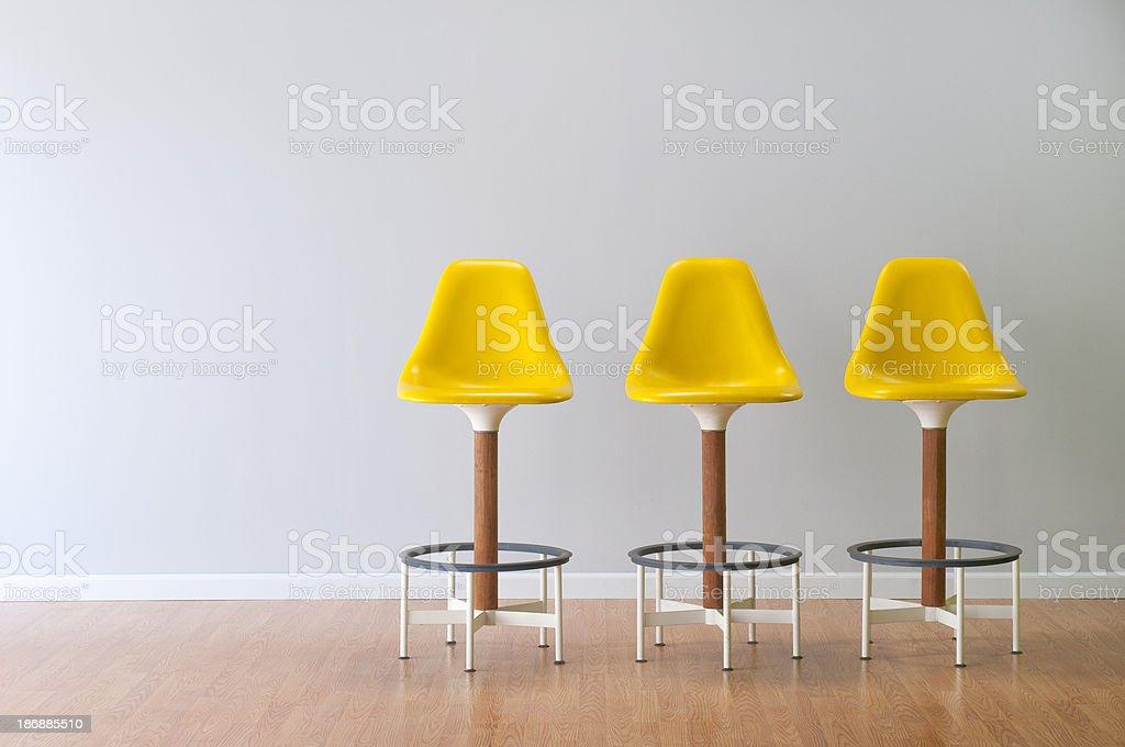 Retro Yellow Stools In Empty Room stock photo