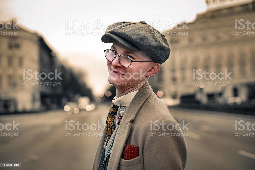 Retro young man walking in a city stock photo