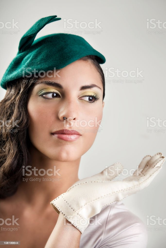 Retro Young Woman Wearing Green Hat and White Gloved royalty-free stock photo