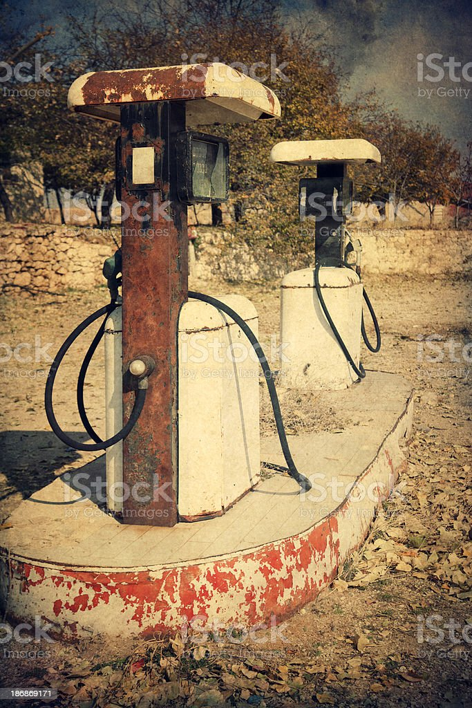 Retro-style photo of abandoned gas station pumps royalty-free stock photo