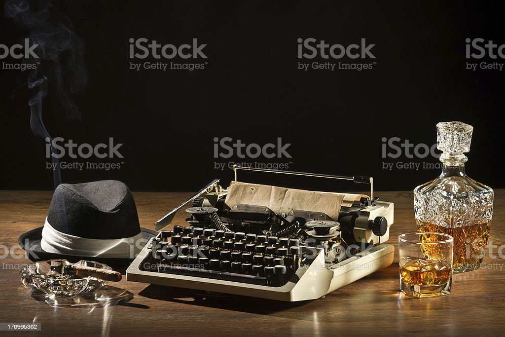 Retro-Styled old typewriter, cigar, hat and whisky with carafe royalty-free stock photo