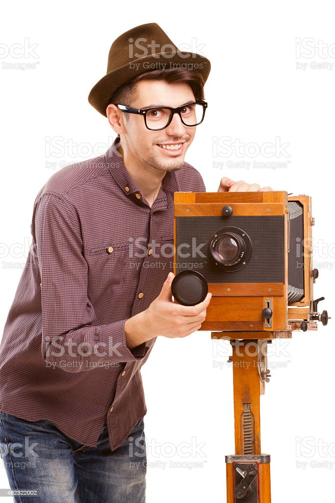 Retro-styled photographer with antique wooden camera stock photo