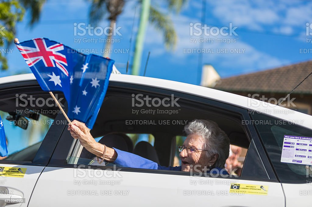 Returned Services Veteran With Australian Flag at ANZAC Day stock photo