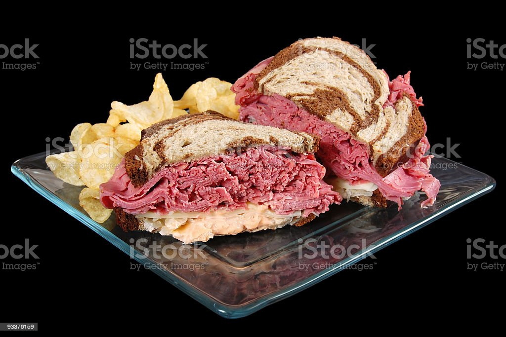 Reuben sandwich on marble rye served with a side of chips royalty-free stock photo