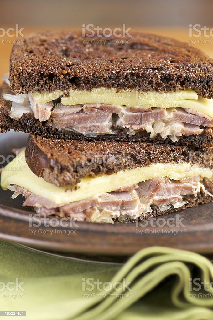 Reuben Sandwich with Corned Beef on Dark Rye Bread royalty-free stock photo