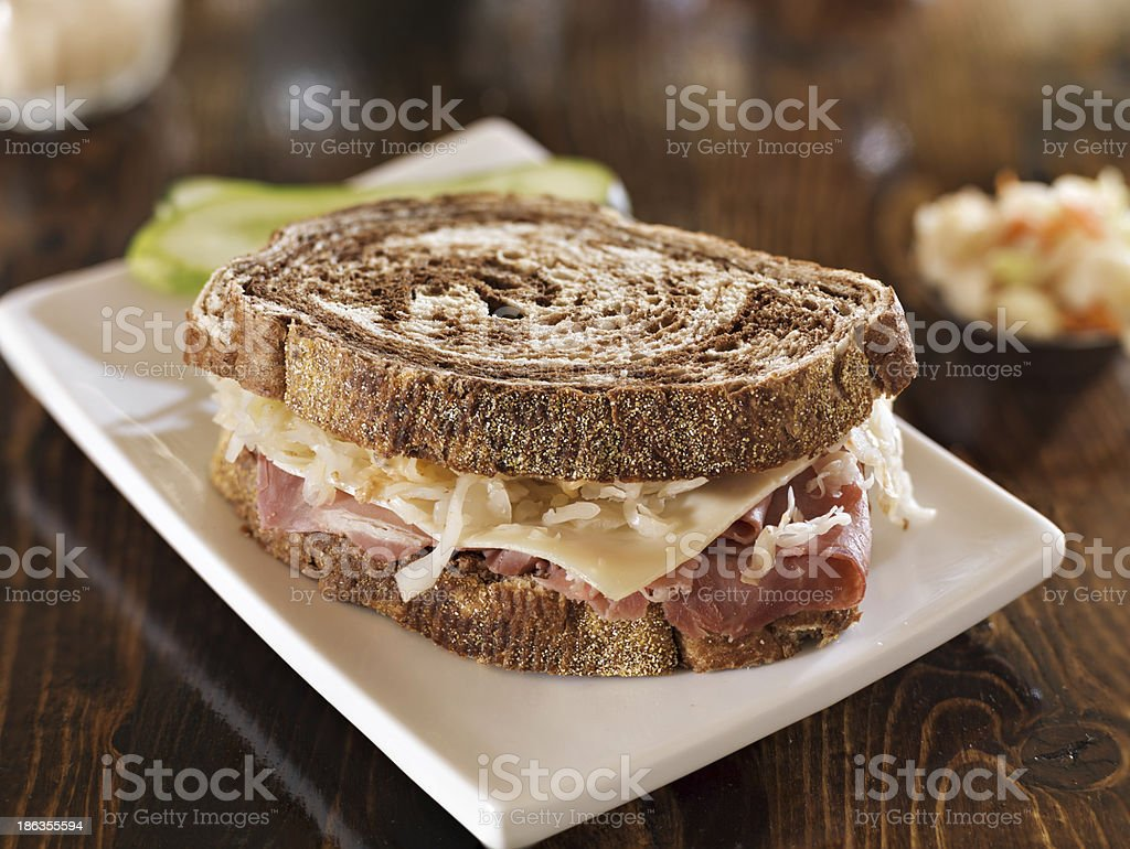 reuben sandwich with kosher dill pickle and coleslaw stock photo