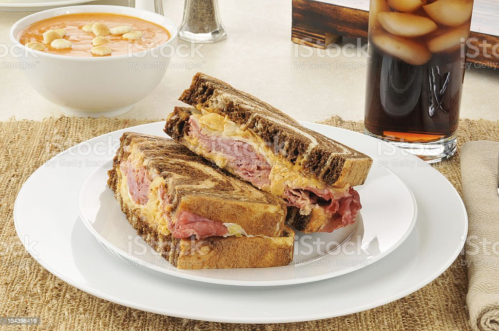 Reuben sandwich with tomato bisque stock photo