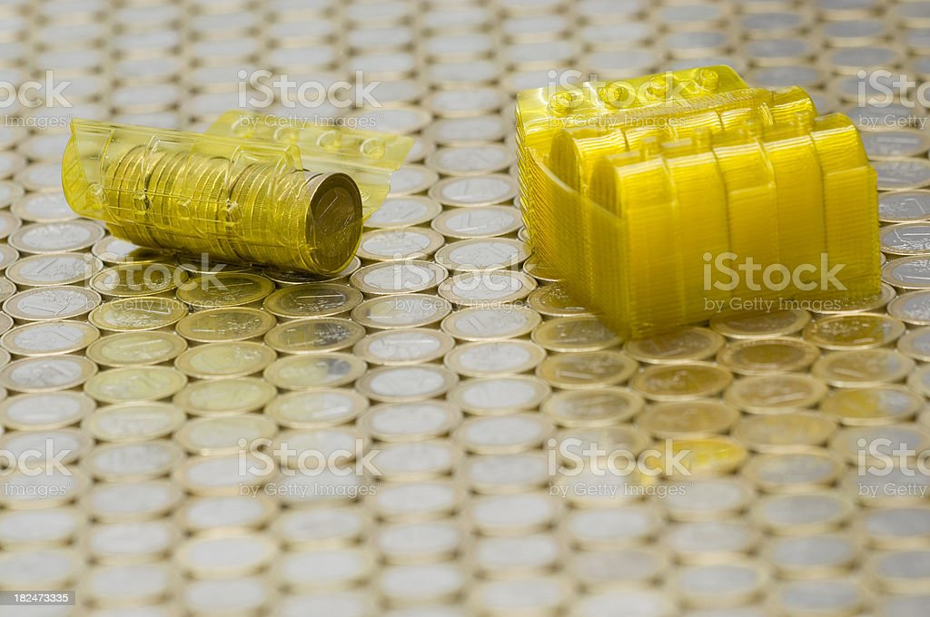 Reusable coin roll on euro background stock photo