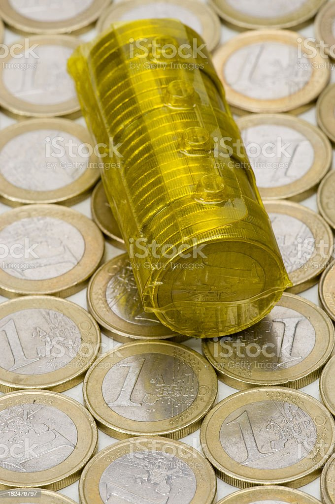Reusable coin roll on euro coins background stock photo