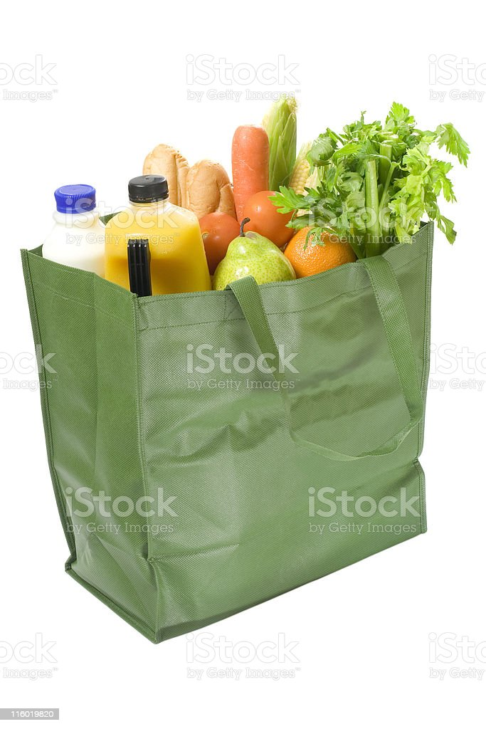 Reusable shopping bag full of groceries royalty-free stock photo