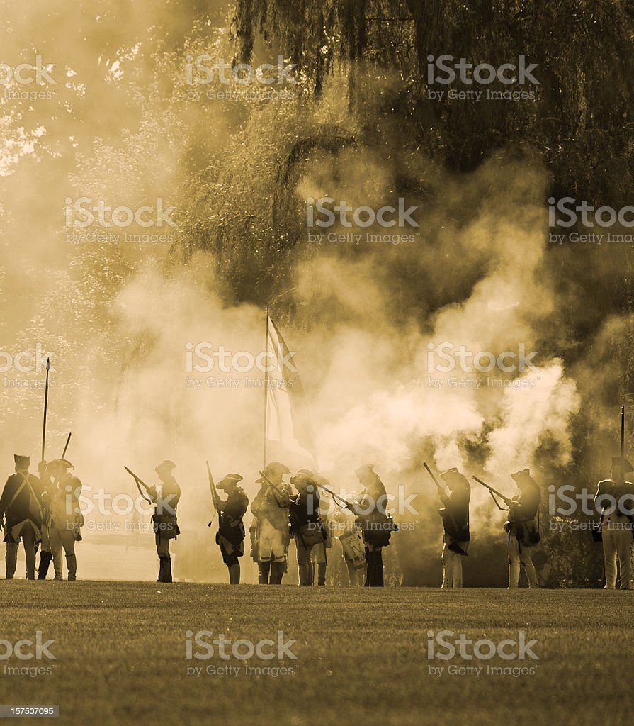 Rev war soldiers silloutted in cannon smoke stock photo