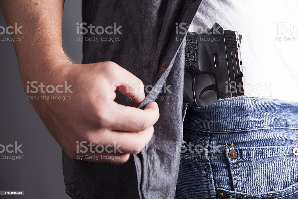 Revealing Firearm stock photo