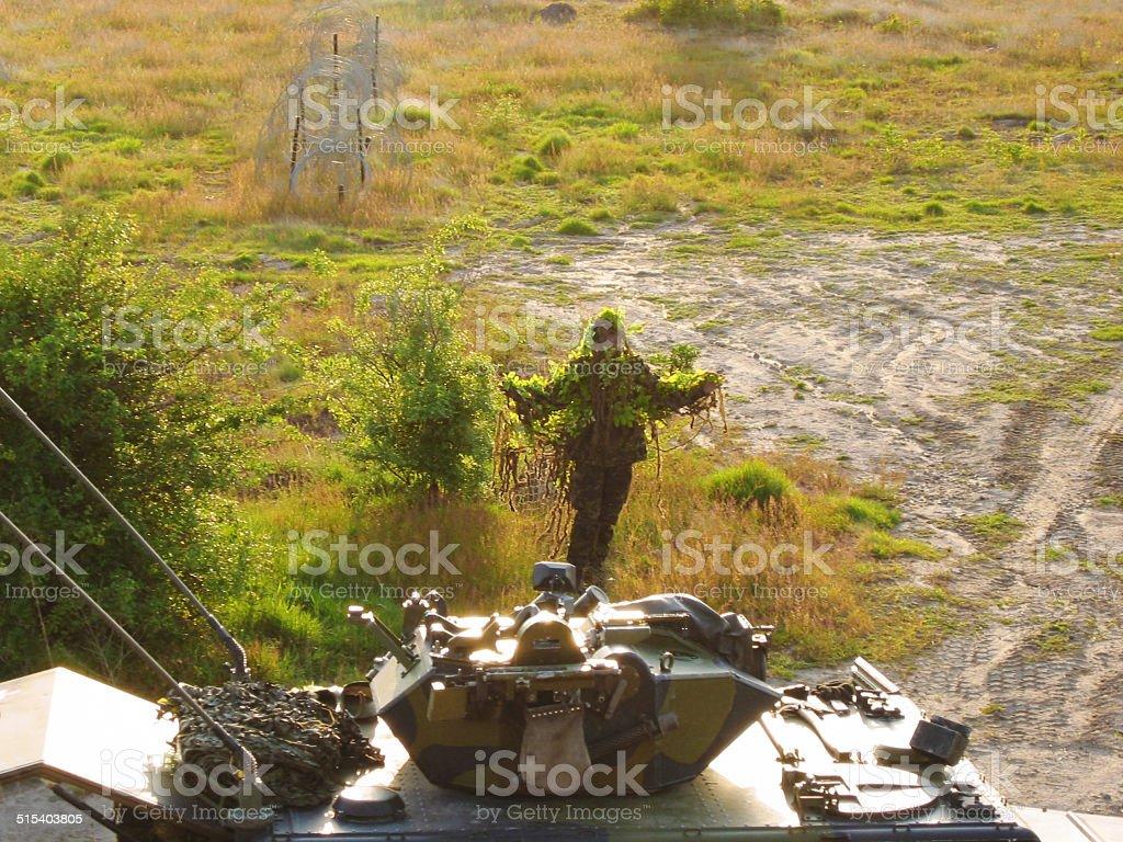 Revealing himself - Camouflaged stock photo