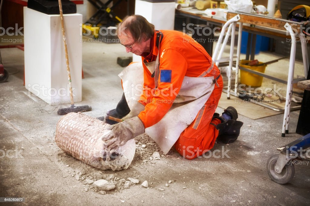 Revealing the figure inside the mold stock photo