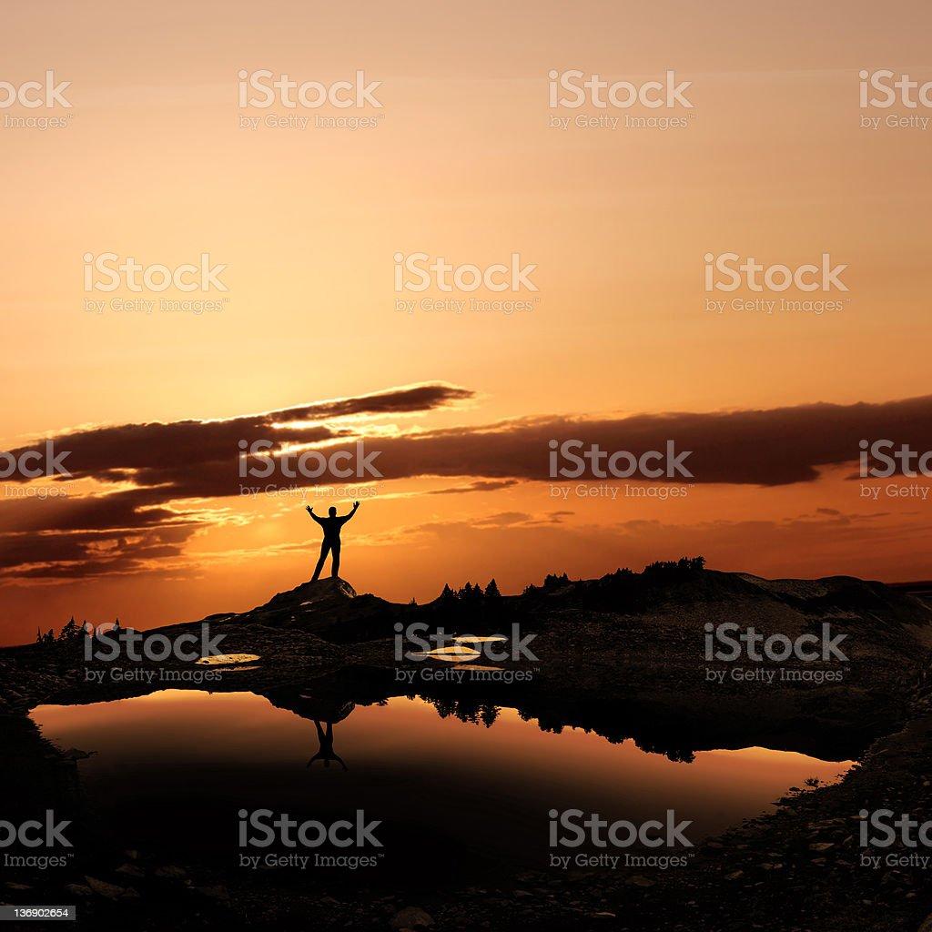 reverent man silhouette stock photo