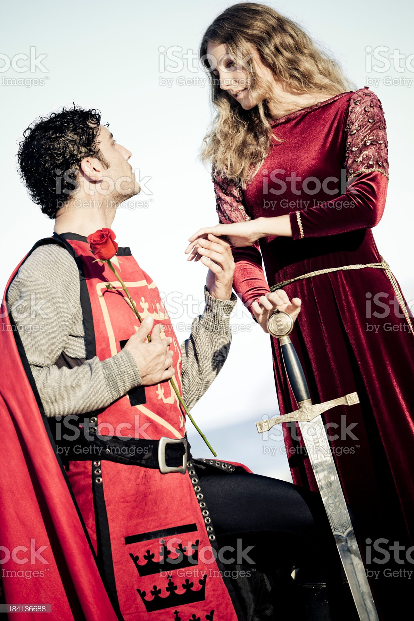 reverential kneeling knight and medieval lady royalty-free stock photo
