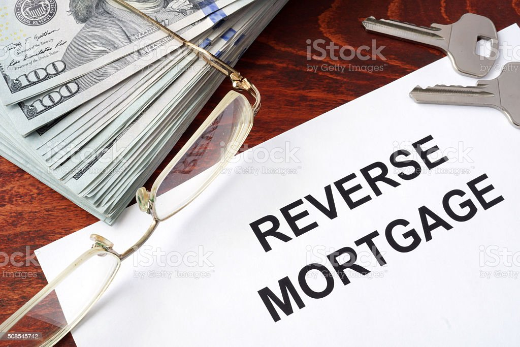 Reverse mortgage form on a table and money. stock photo