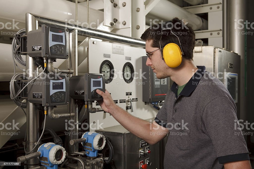 Reverse Osmosis Water Purification Plant Technician Checks System Settings royalty-free stock photo