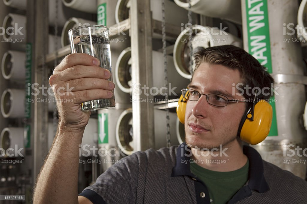 Reverse Osmosis Water Purification Plant Technician Inspects Quality stock photo
