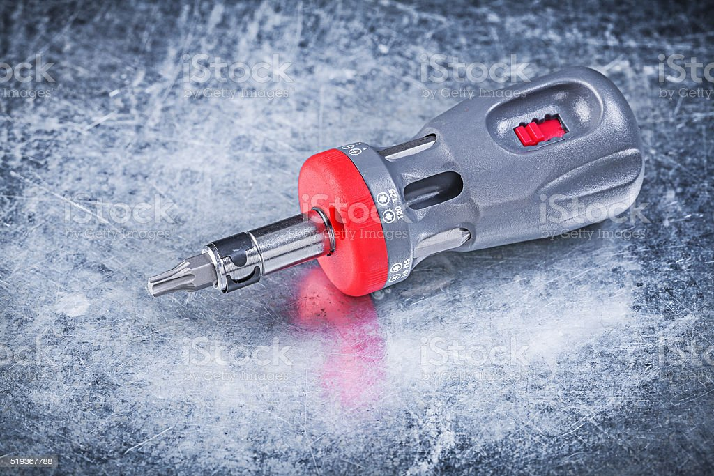 Reversible screwdriver on metallic background construction conce stock photo