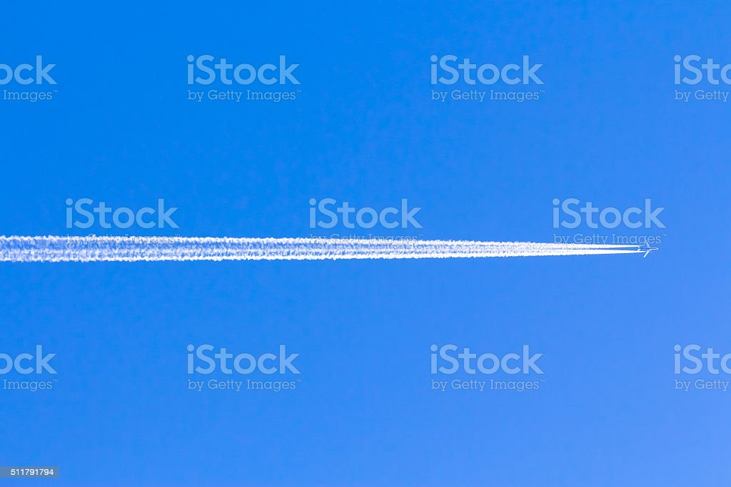 Reversing the trace of the plane in the blue sky without clouds stock photo