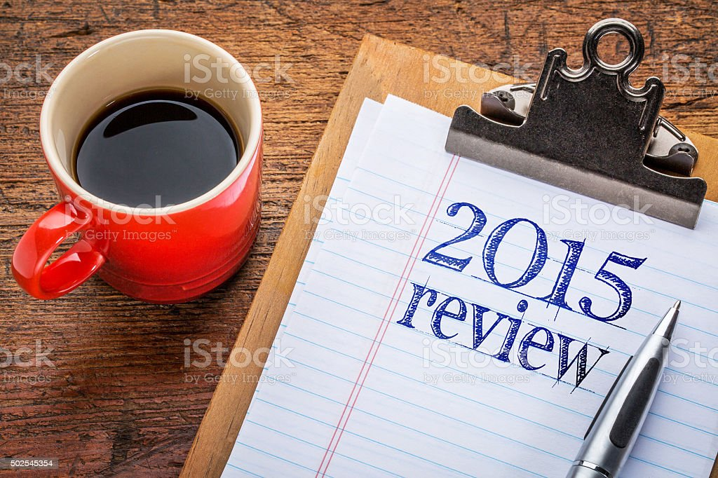 2015 review on blackboard on clipboard stock photo