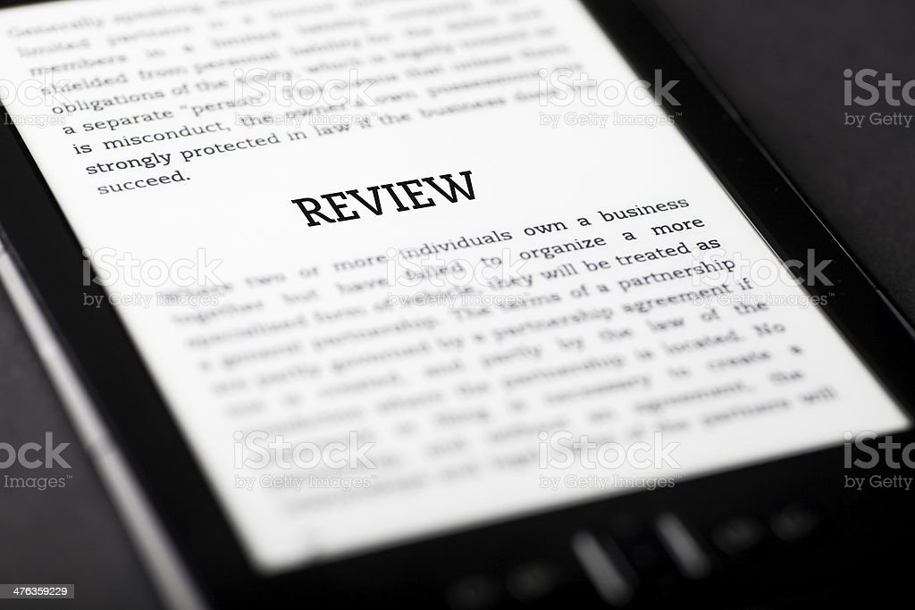 Review on tablet touchpad, ebook concept royalty-free stock photo