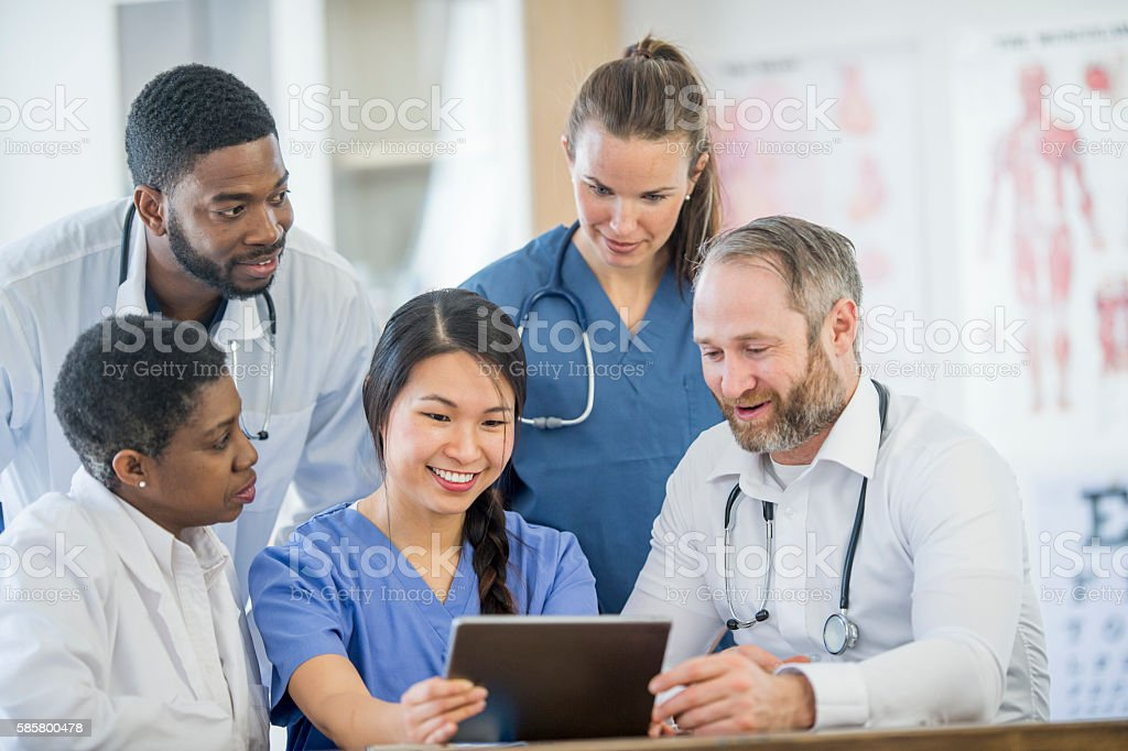 Reviewing a Patients Case at the Hospital stock photo