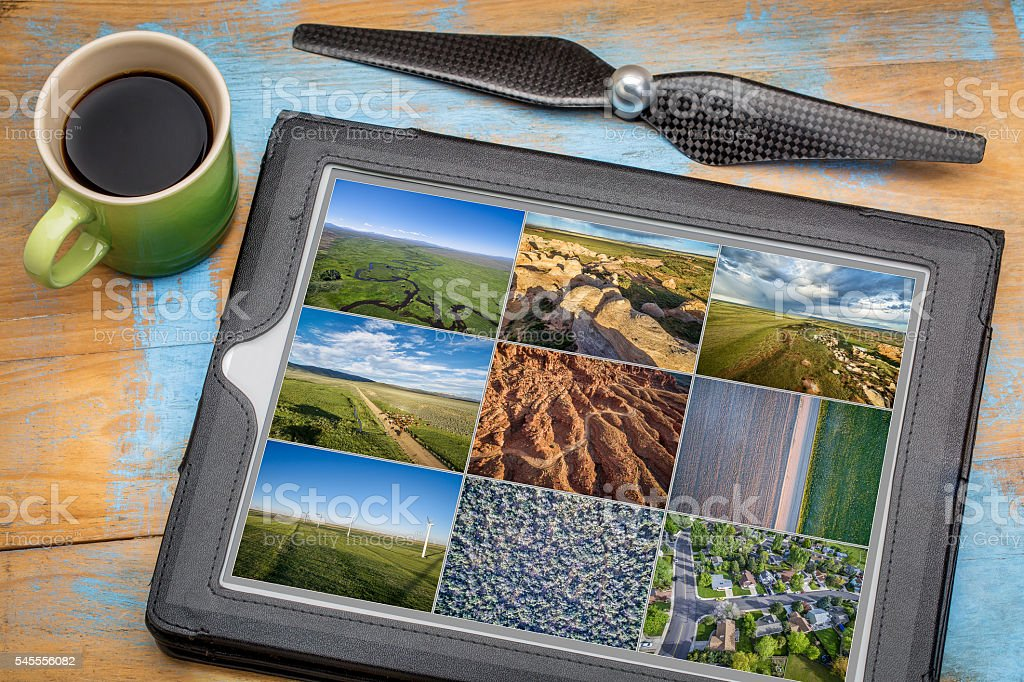 Reviewing aerial pictures on tablet stock photo
