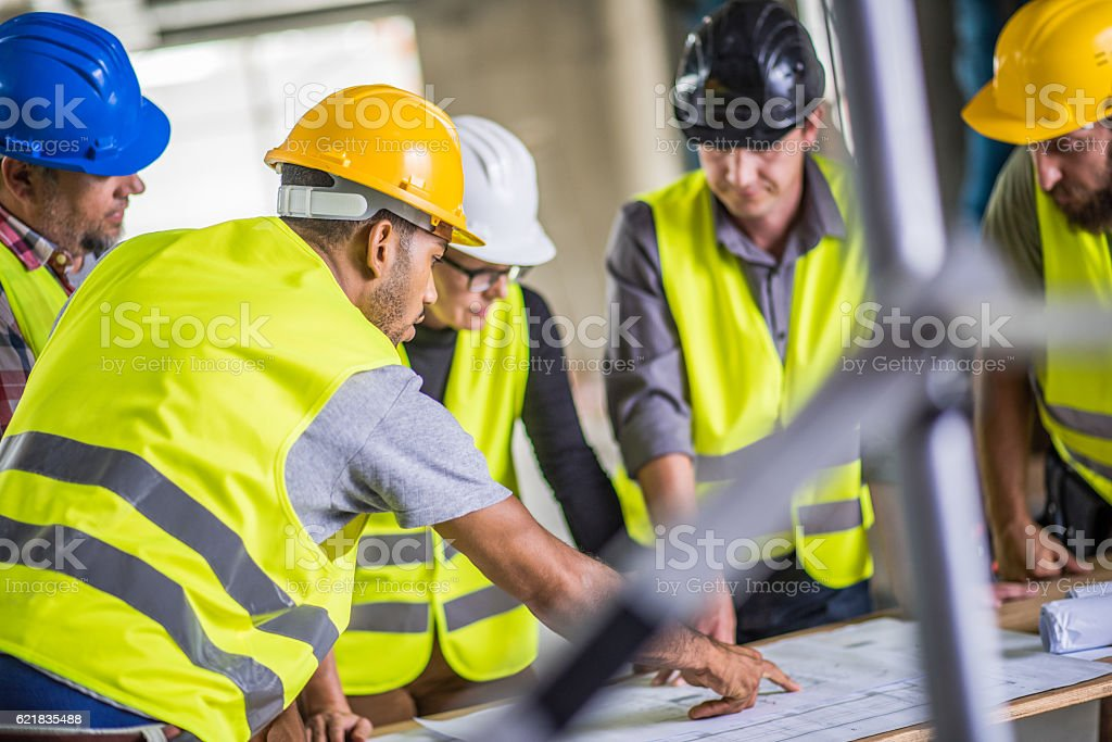 Reviewing blueprint stock photo