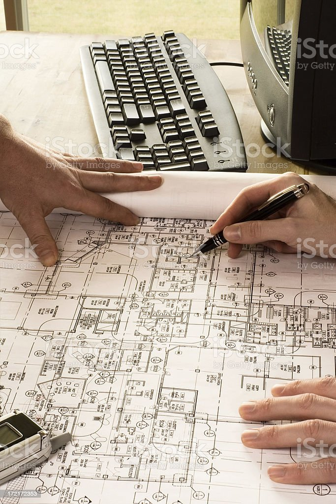 Reviewing Blueprints.  brighter. royalty-free stock photo