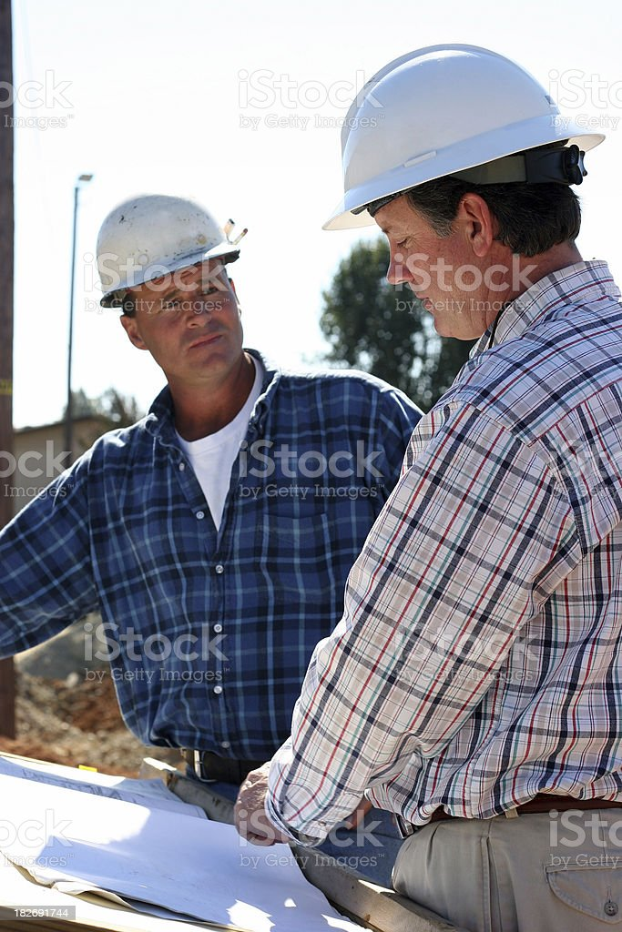 Reviewing Blueprints Together royalty-free stock photo