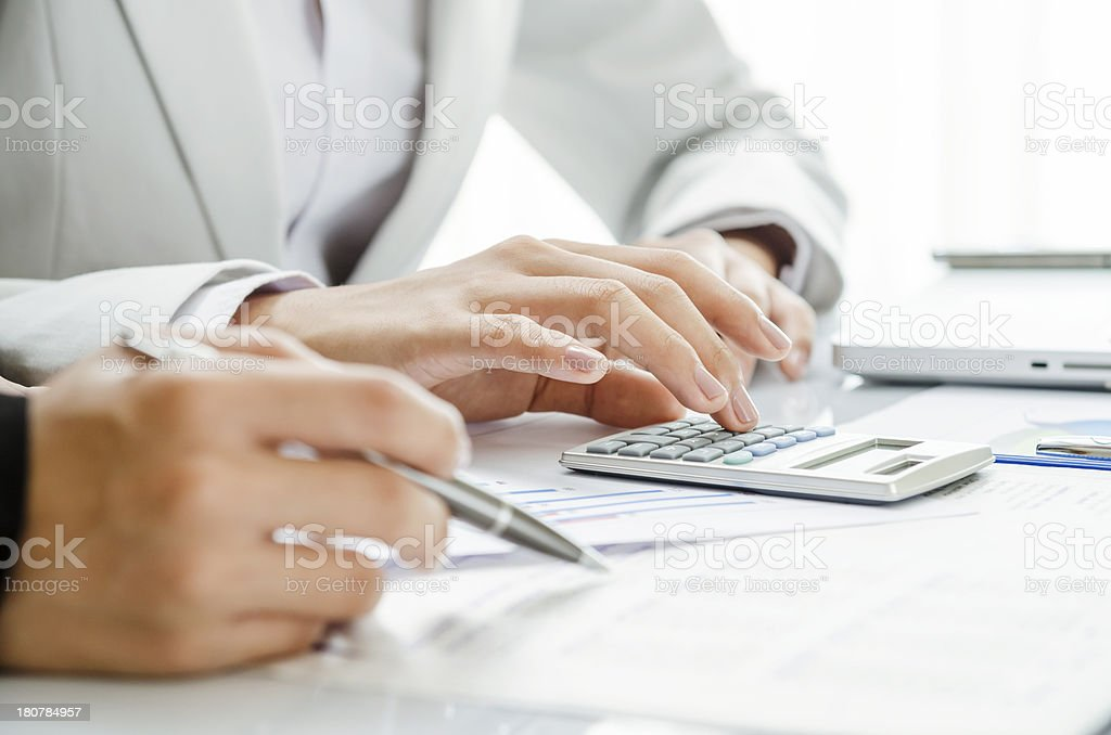 Reviewing financial figure stock photo