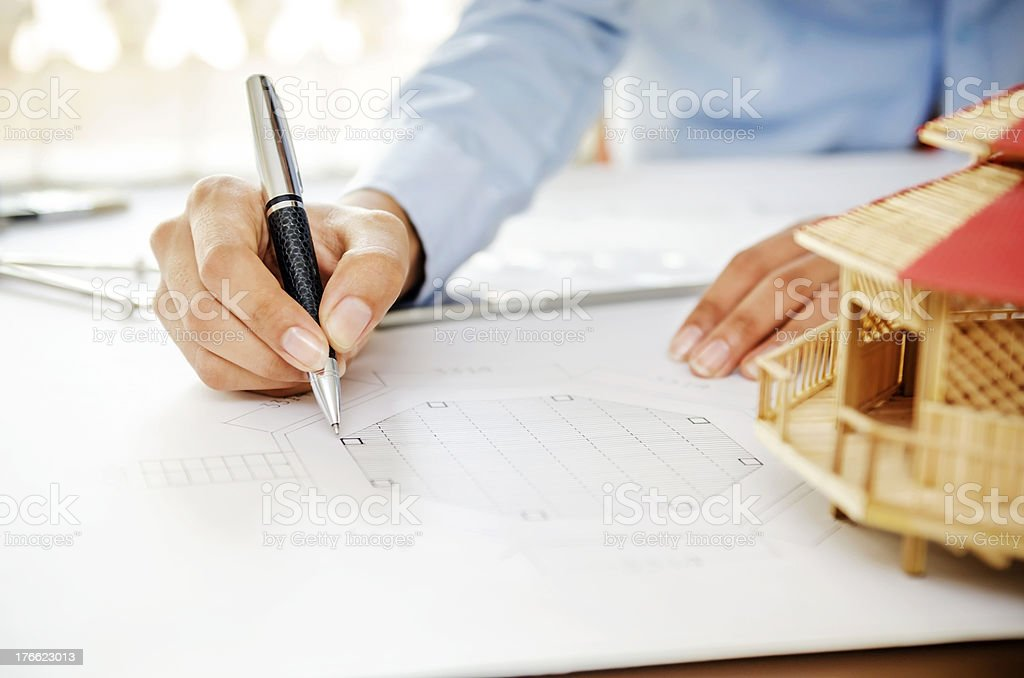Reviewing floor plan royalty-free stock photo