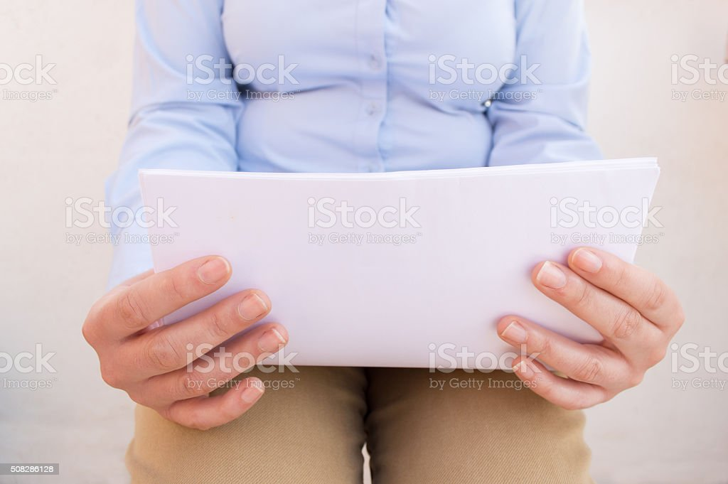 reviewing notes at a waiting room stock photo