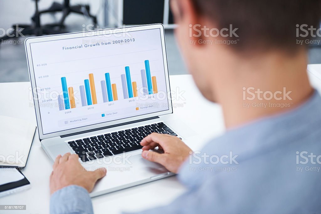 Reviewing the growth figures stock photo