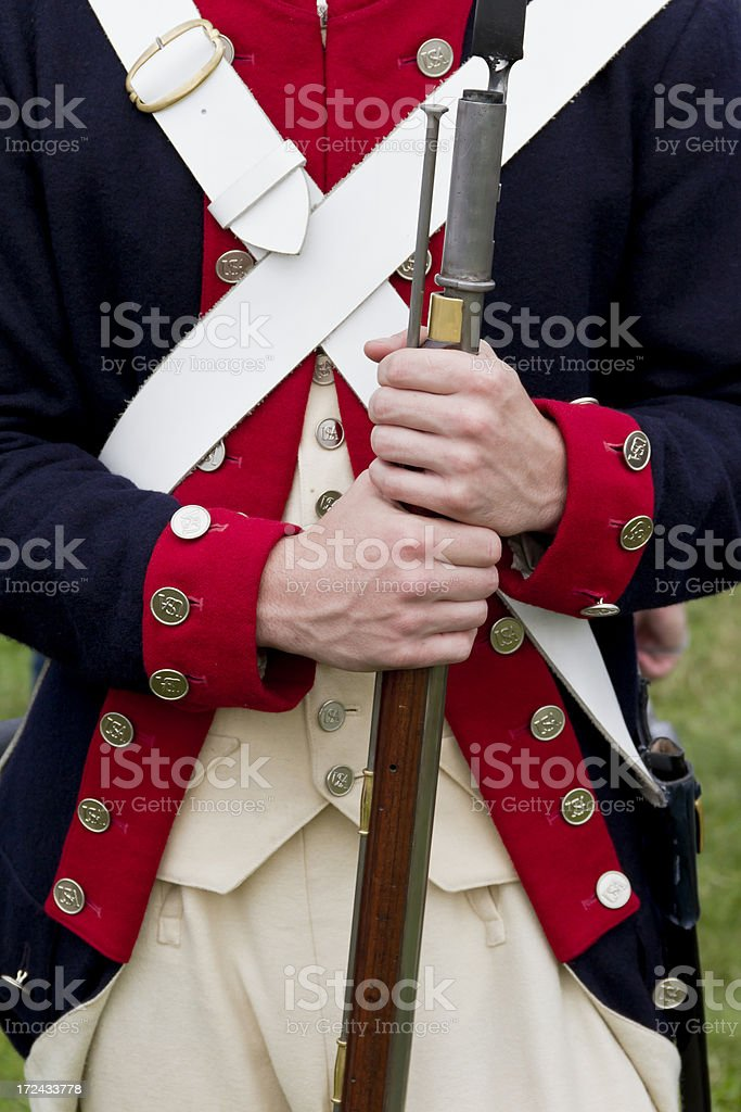 Revolutionary War Soldier Holding His Musket stock photo