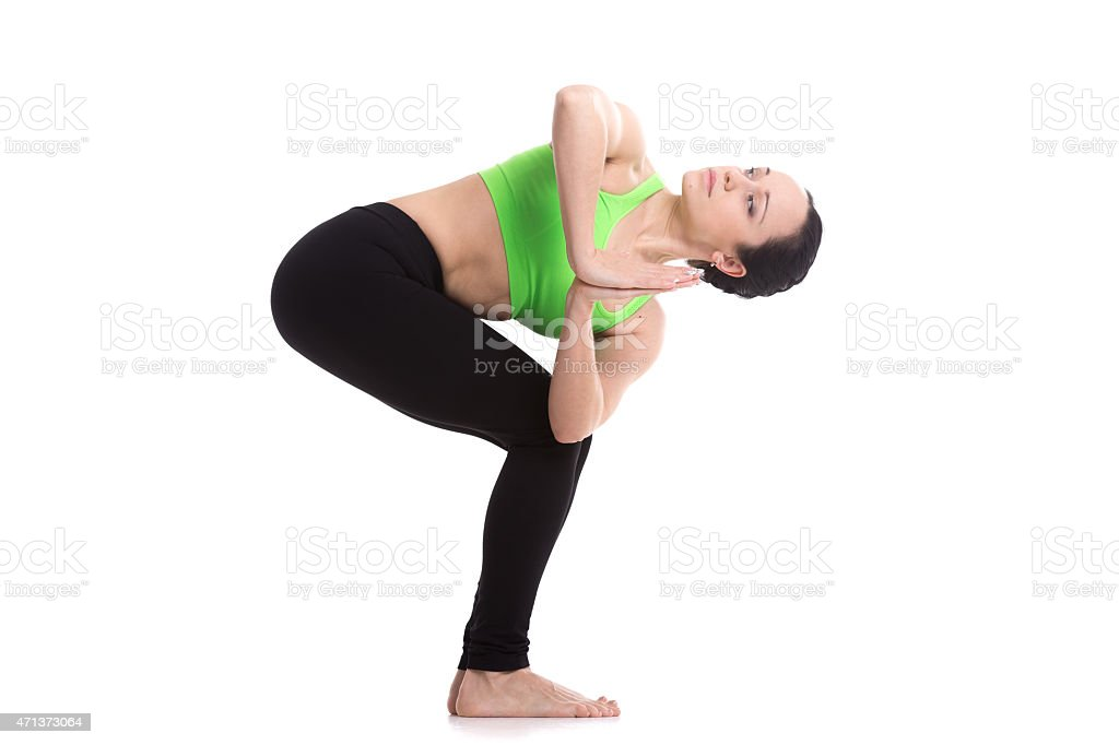 Revolved chair yoga pose stock photo