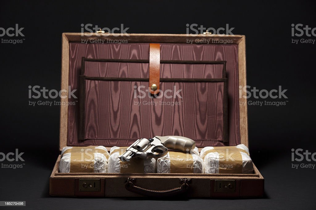 Revolver and Drugs in a Briefcase stock photo