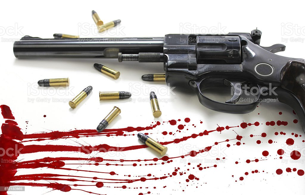 Revolver Pistol with Bullets and Blood Splatter stock photo