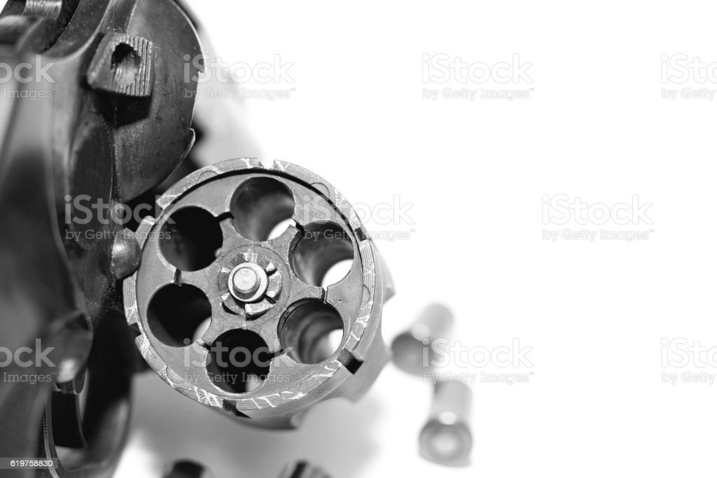 Revolver with bullets close-up isolated on white background stock photo