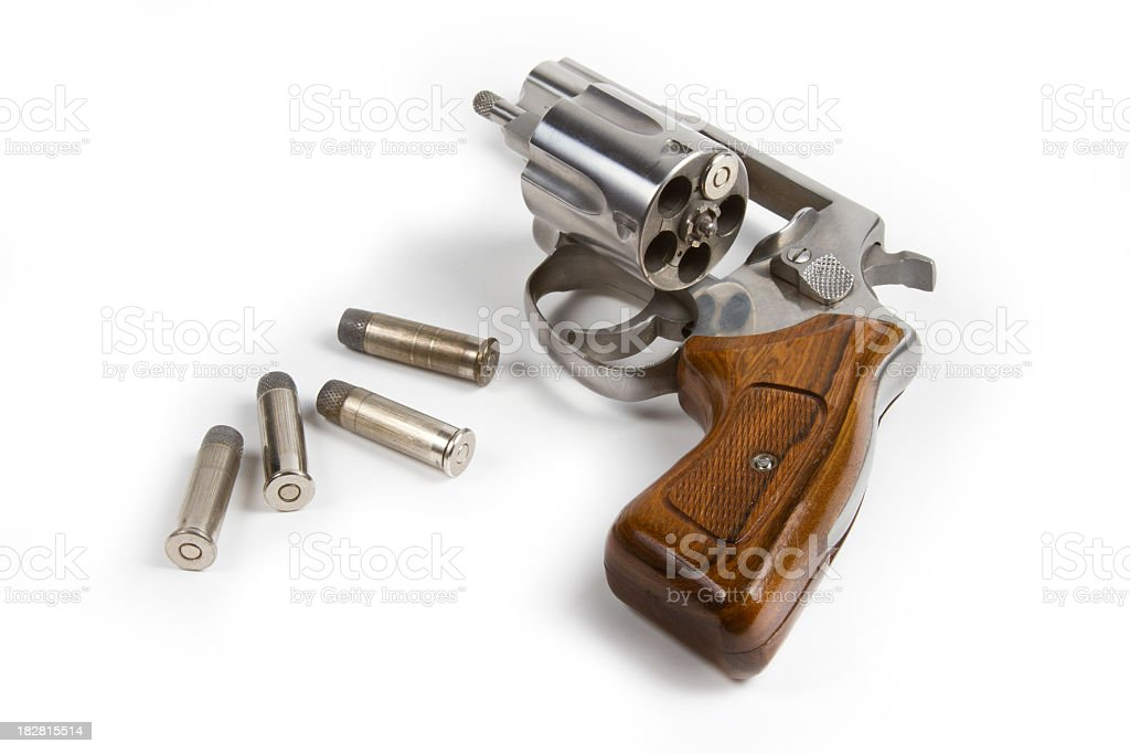 Revolver with bullets on white background royalty-free stock photo