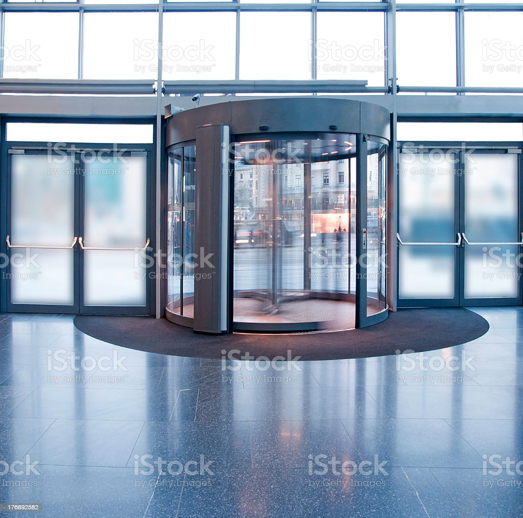 Revolving door in a building lobby stock photo
