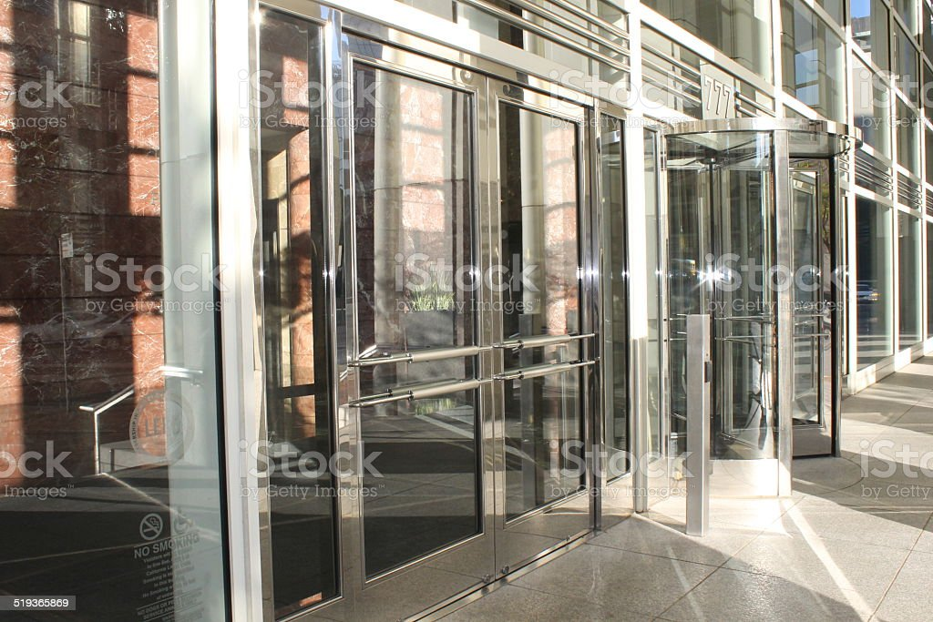 Revolving Glass Doors with LensFlare stock photo