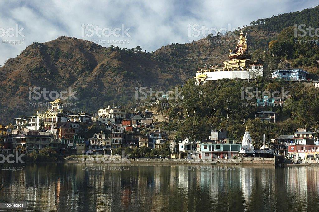 Rewalsar lake with golden statue of Padmasambhava,Himachal pradesh,India stock photo