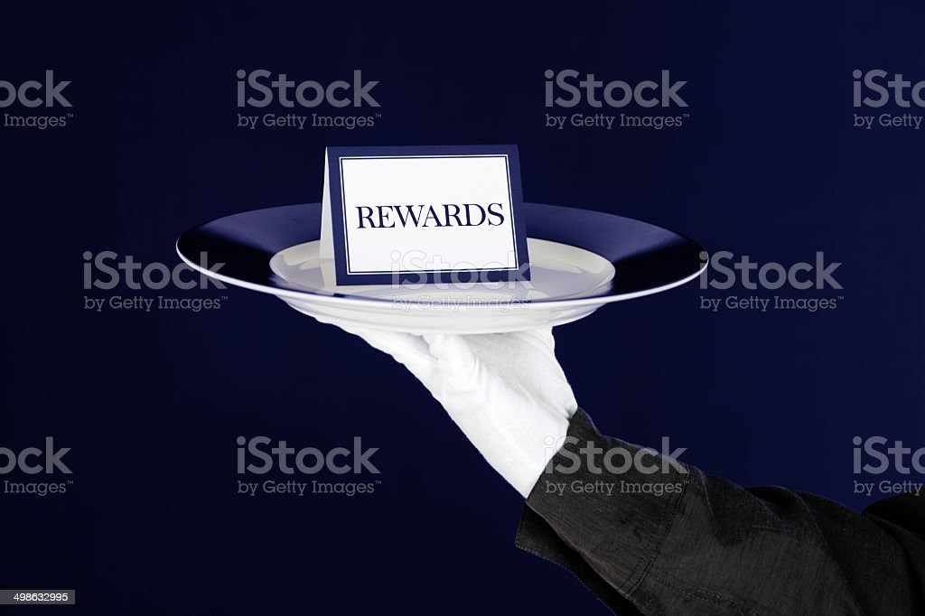 Rewards Card On Platter Held By Waiter stock photo