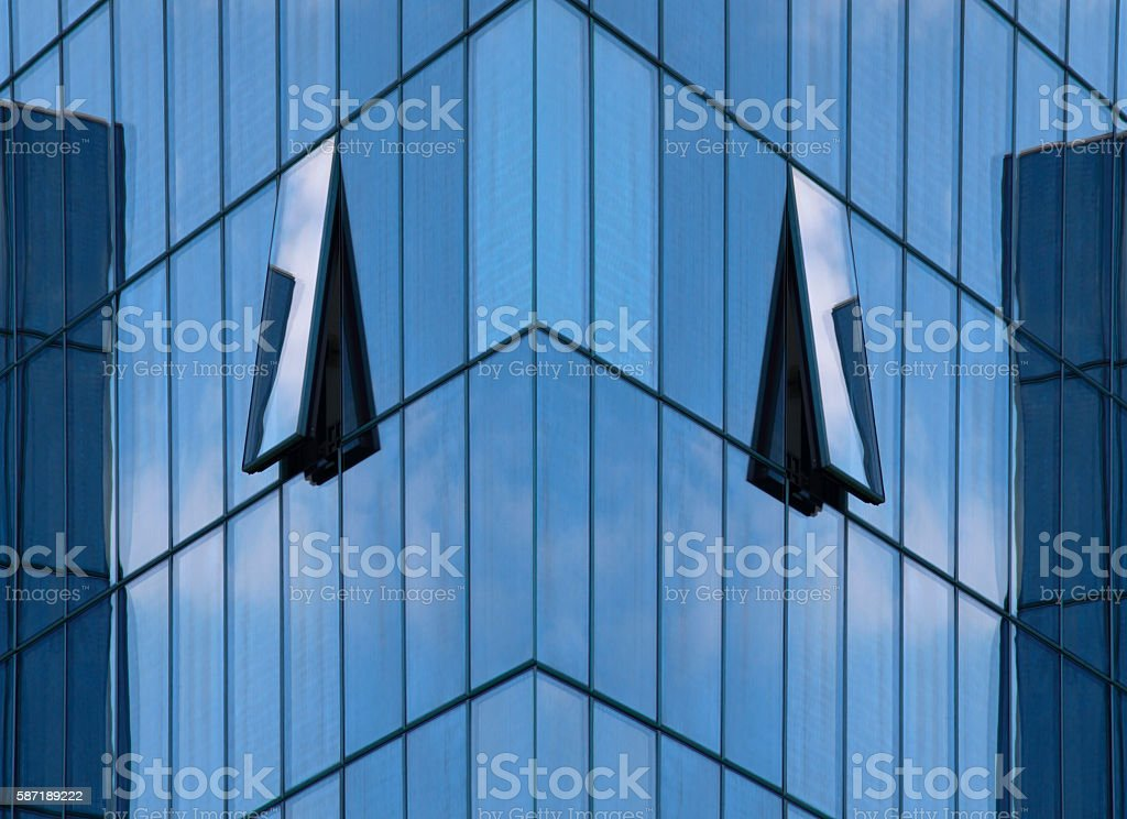 Reworked office building with ajar windows on all-over grazing stock photo