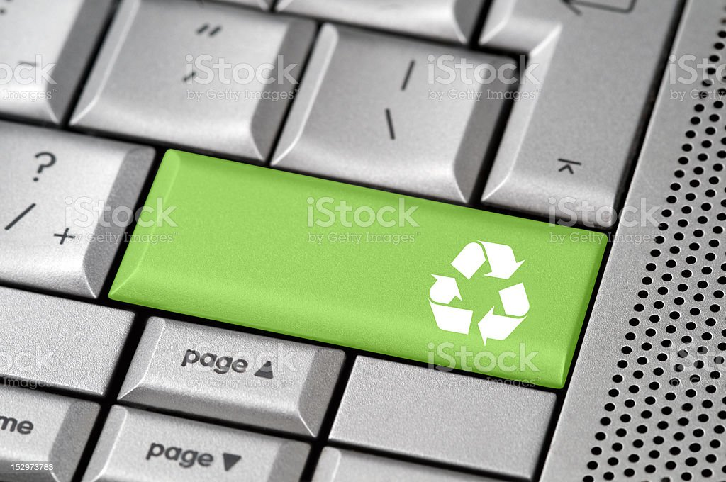 Reycle button concept on a laptop keyboard royalty-free stock photo
